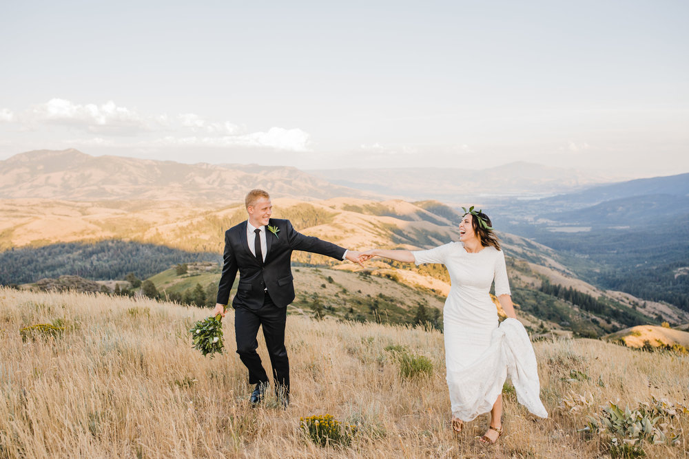 best professional photographer in brigham city utah bridals mountains holding hands laughing floral crown