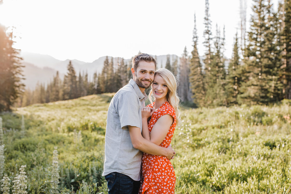 alta utah engagement photographer hugging smiling happy mountains fields