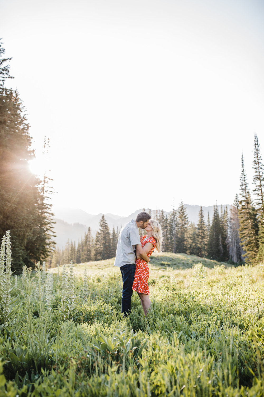 albion basin engagement photographer sunset kissing romantic mountains