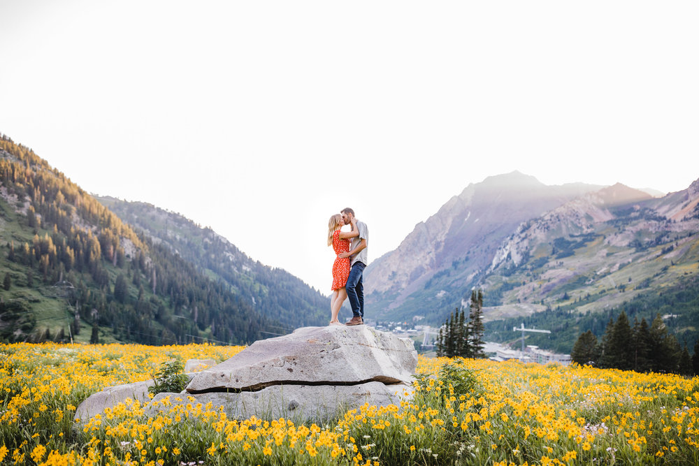 engagement photographer in albion basin kissing rock sunset mountains wildflower field