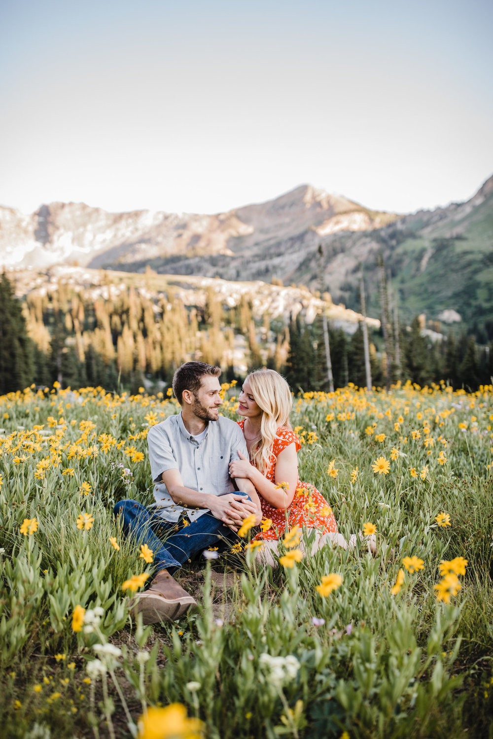 alta utah engagement photographer wildflower field mountains sunset
