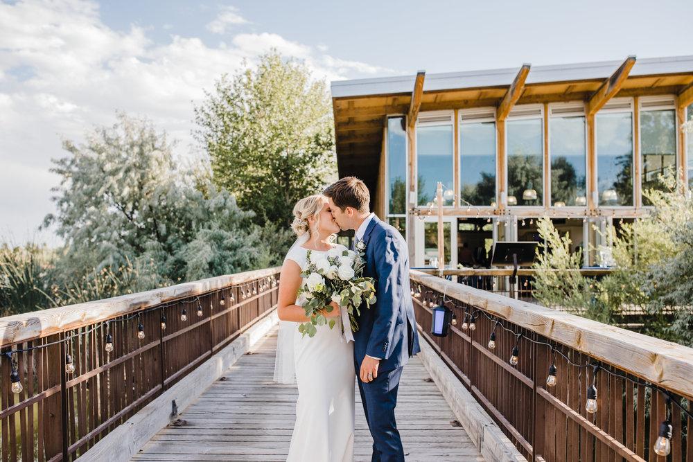 professional san diego wedding photographer kissing romantic reception string lights