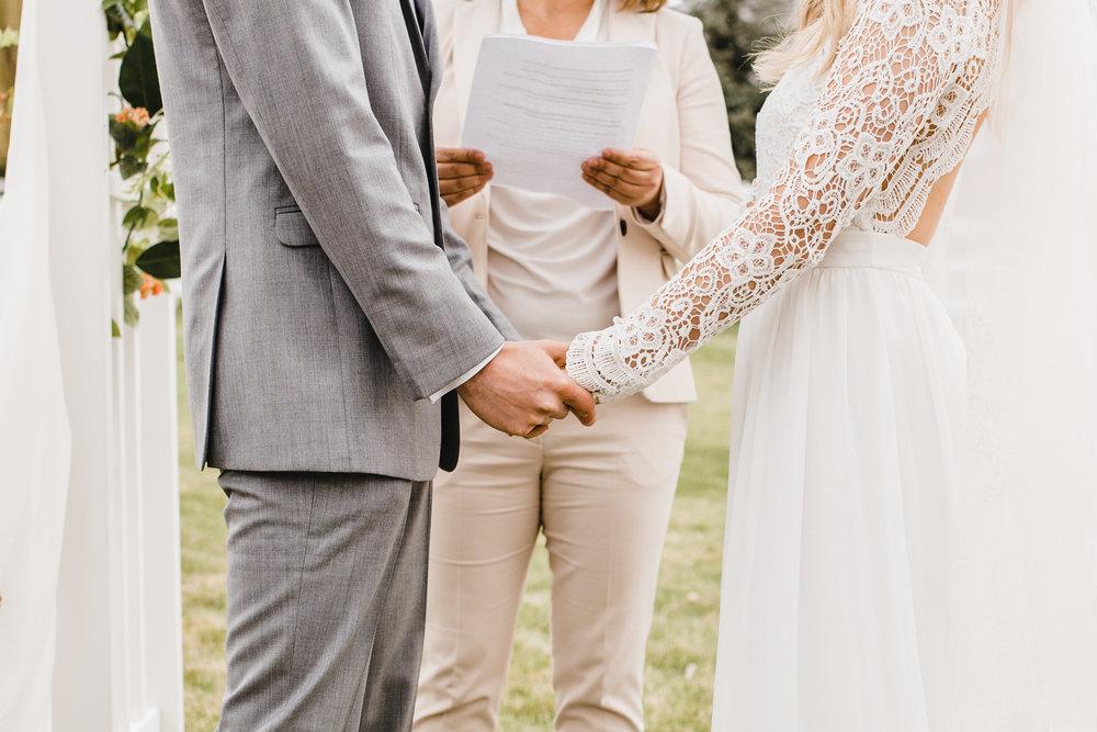 professional wedding photographer in las vegas nevada holding hands ceremony