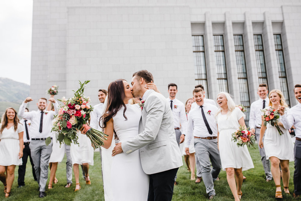 Draper professional wedding photographer wedding party groomsmen bridesmaids walking laughing kissing party