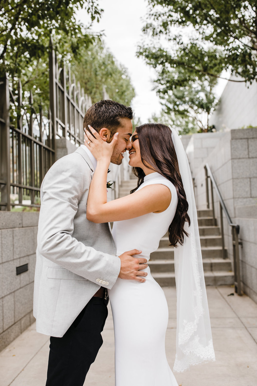 utah valley wedding photographer lds temple kissing laughing romantic