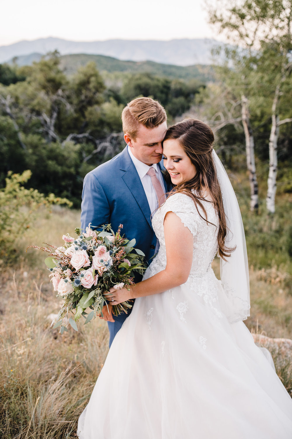 logan utah wedding photographer formals hugging laughing pink tie pink and blue bouquet