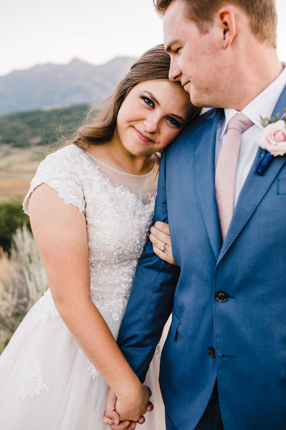 professional wedding photographer in logan utah bridals formals hugging smiling lace dress
