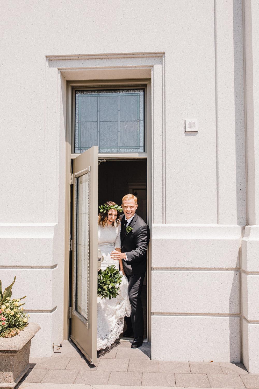 professional wedding photographer in brigham city utah lds temple exit smiling