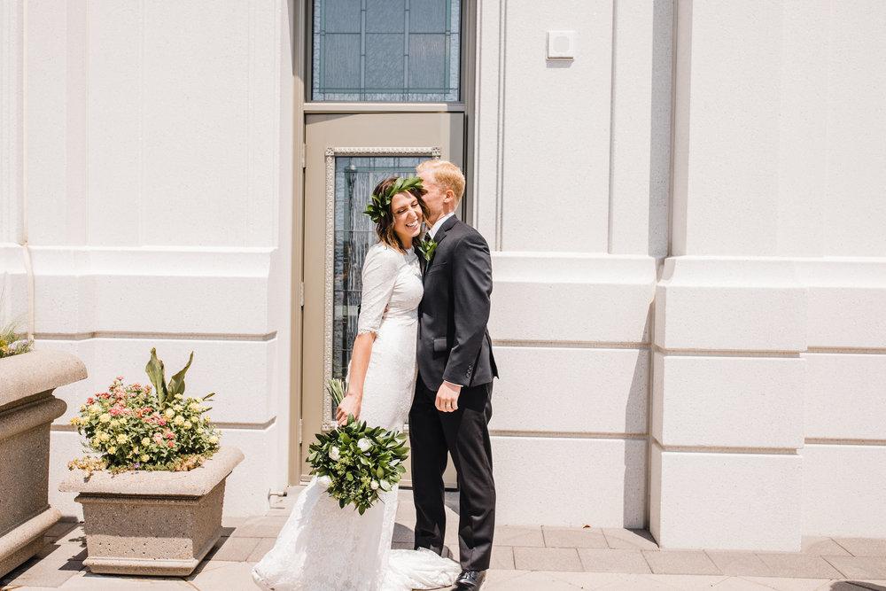best photographer in brigham city utah wedding exit kissing romantic happy
