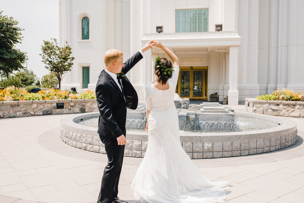 professional wedding photographer in brigham city temple lds fountains dancing spinning twirling floral crown