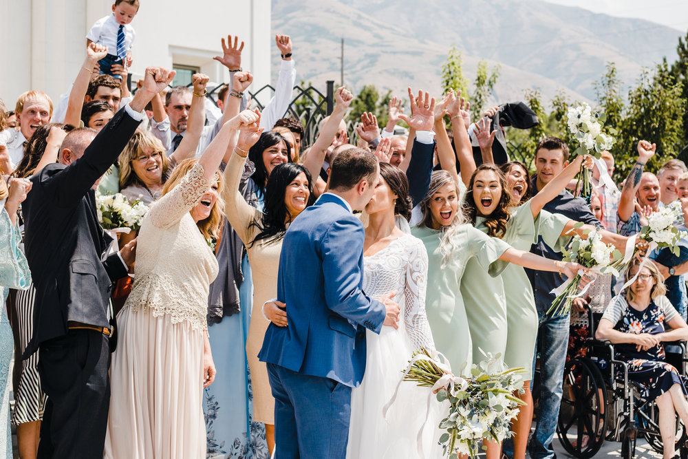 brigham city utah wedding photographer wedding exit cheering lds families temple wedding green bridesmaids dresses
