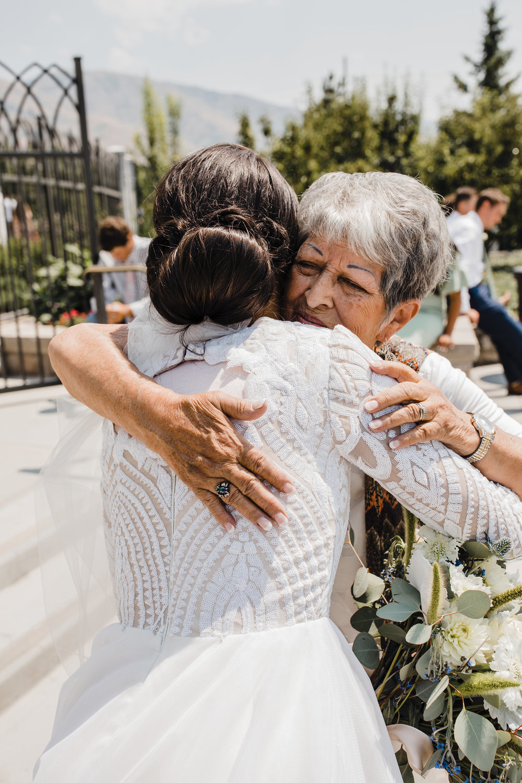 brigham city wedding photographer professional hugging wedding exit grandmother