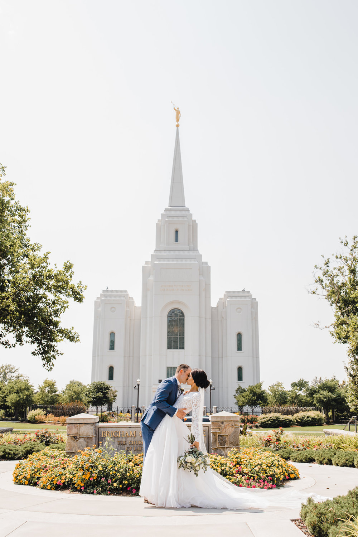 professional wedding photographer in brigham city utah lds temple dip kissing romantic
