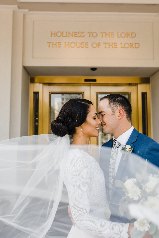brigham city utah wedding photographer lds temple exit long windy veil kissing romantic