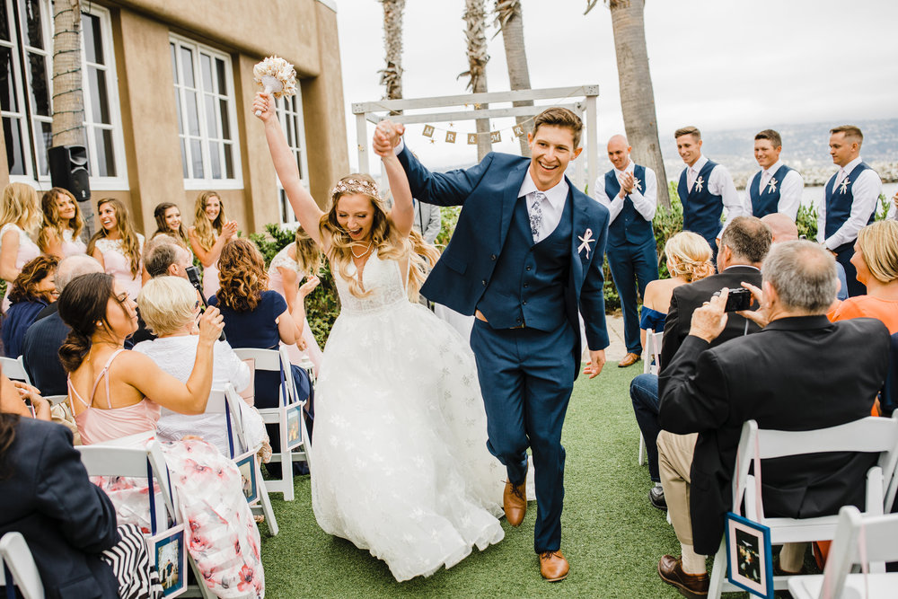 destination outdoor wedding ceremony in los angeles california blue navy three piece suit bride with bohemian floral headpiece