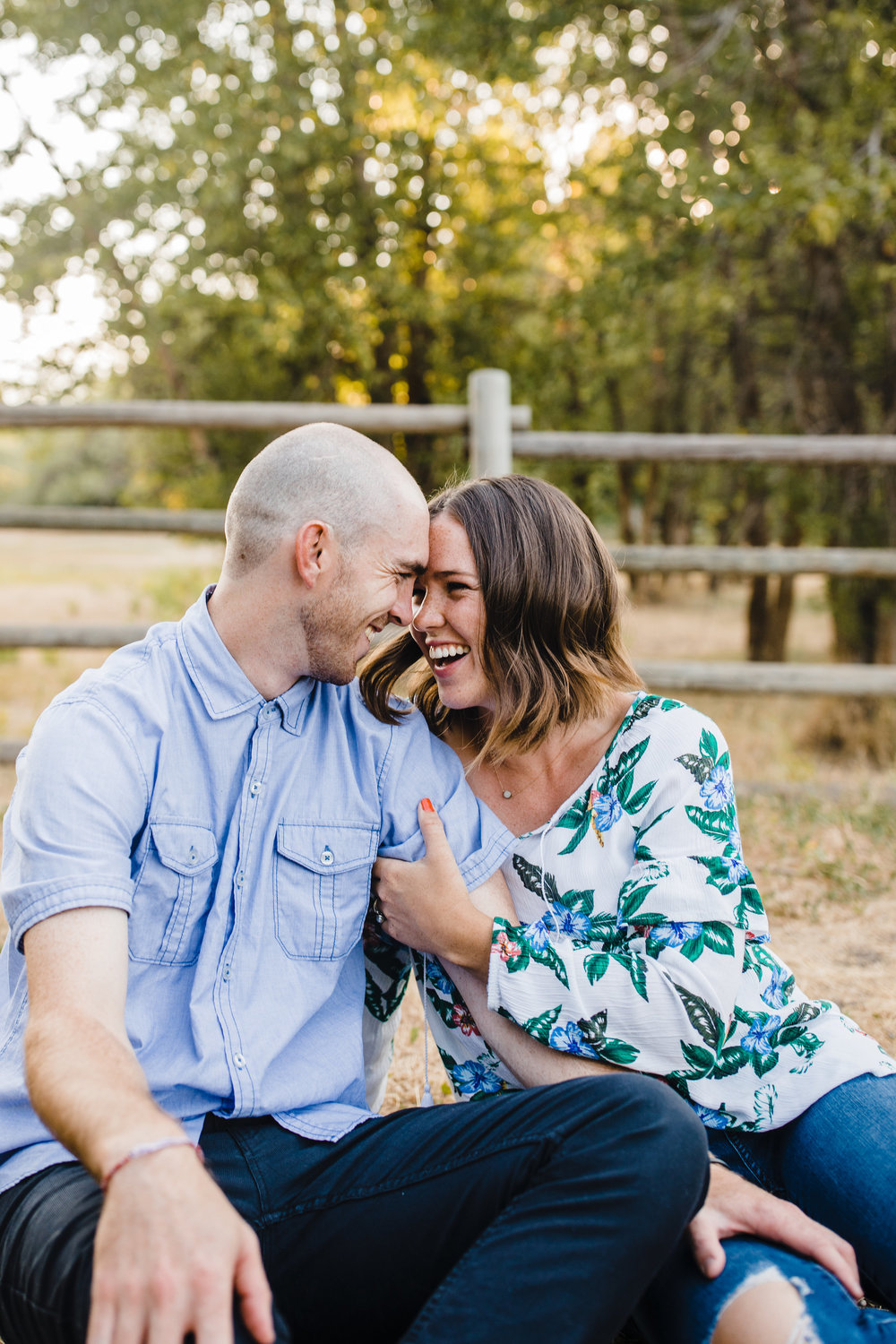 logan utah couples photographer smiling laughing hugging