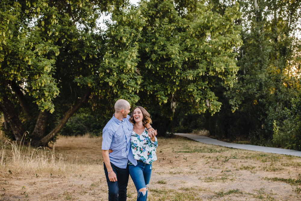 professional cache valley couples photographer laughing smiling walking hugging