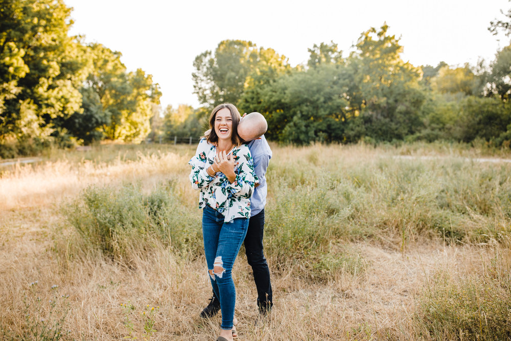 professional couples photographer logan utah kissing hugging laughing playful