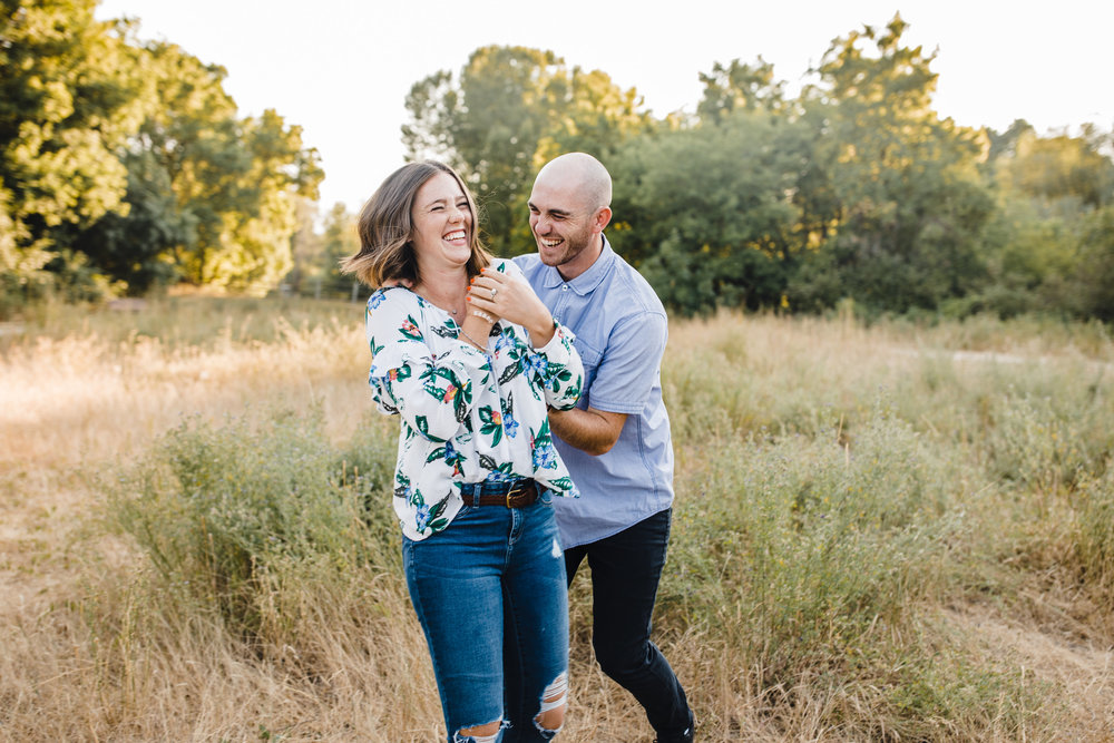 professional couples photographer in logan utah playful hugging spinning