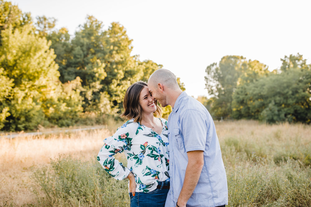 professional logan utah couples photographer laughing smiling hugging nose kisses