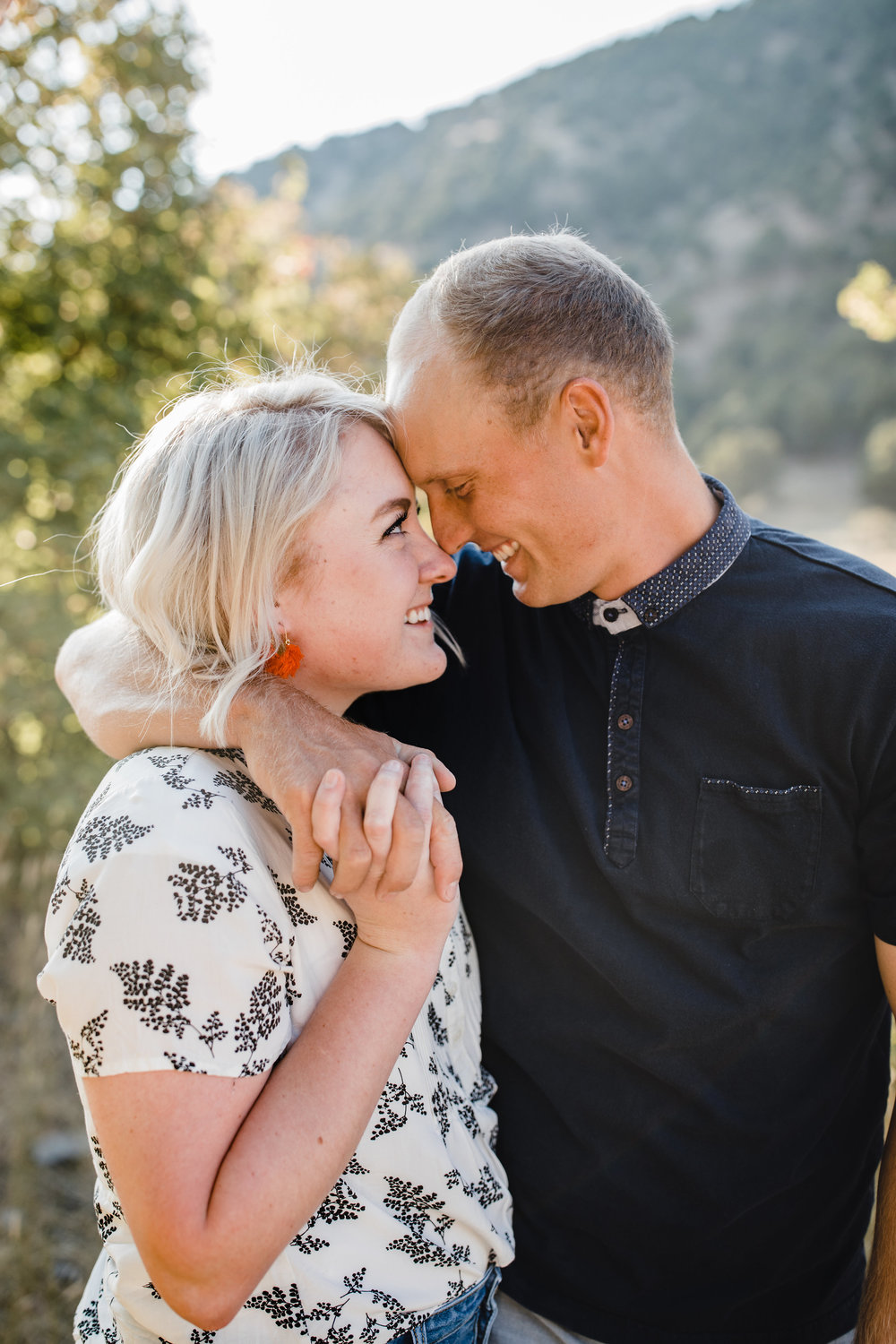 best logan utah couples photographer hugging romantic mountain backdrop