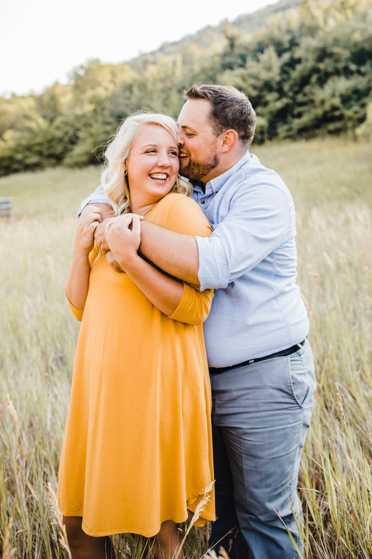 best professional engagement photographer in mantua utah marigold dress laughing hugging