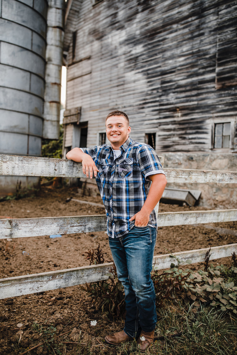 professional portrait photographer olympia washington overcast rustic barn fence leaning