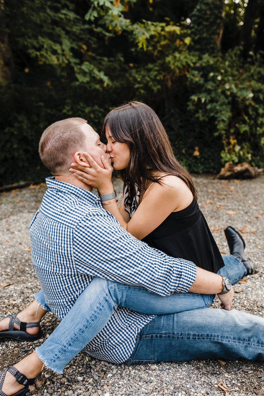best professional engagement photographer in olympia washington beach sitting kissing romantic