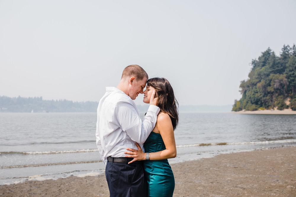 best professional engagement photographer in olympia washington beach kissing holding romantic sunset