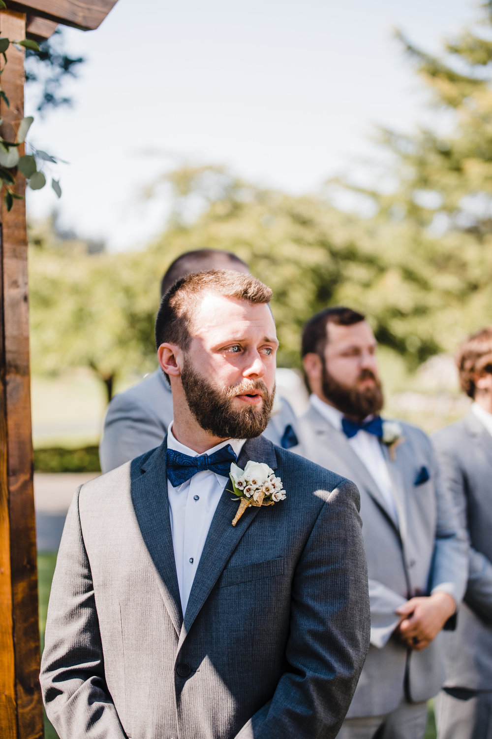 olympia washington professional wedding photographer first look outdoor wedding ceremony wedding arch grooms teary