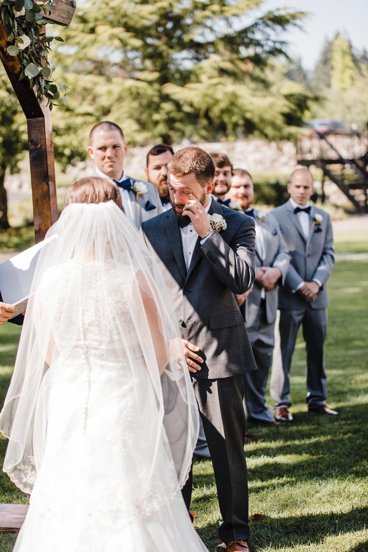 olympia washington professional wedding photographer outdoor wedding ceremony crying first look