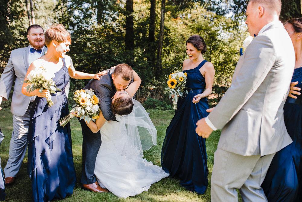 olympia washington professional wedding photographer kissing happy cheering dipping