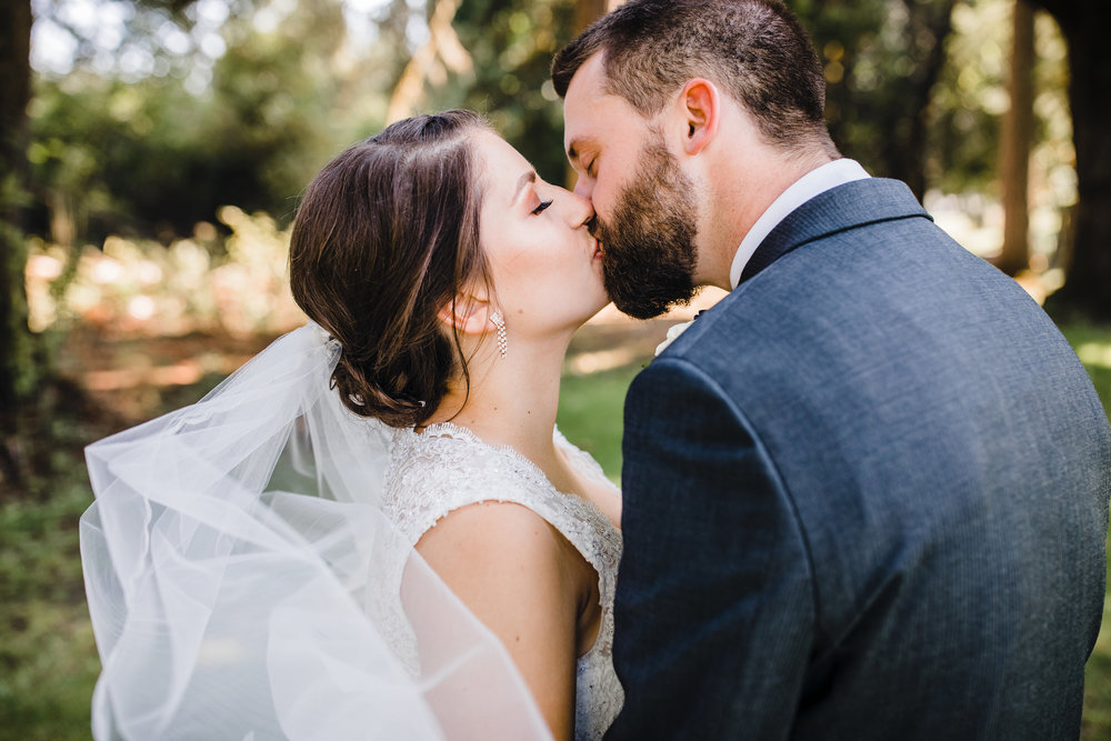 olympia washington professional wedding photographer kissing romantic billowing veil