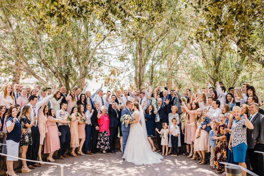professional photographer in las vegas cheering wedding exit lds temple happy