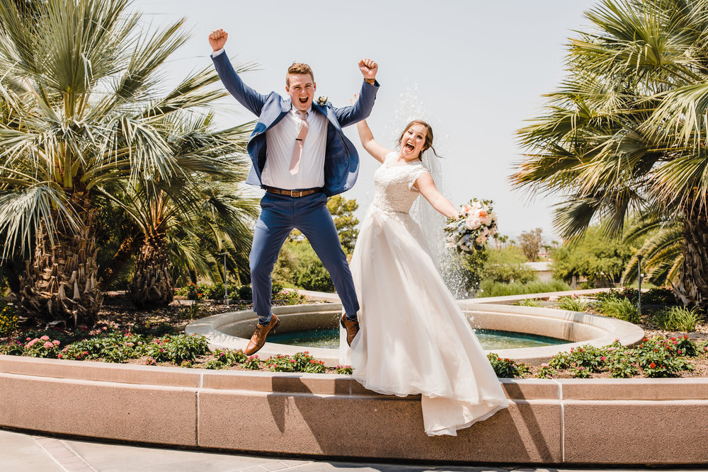 professional las vegas wedding photographer cheering jumping hands up