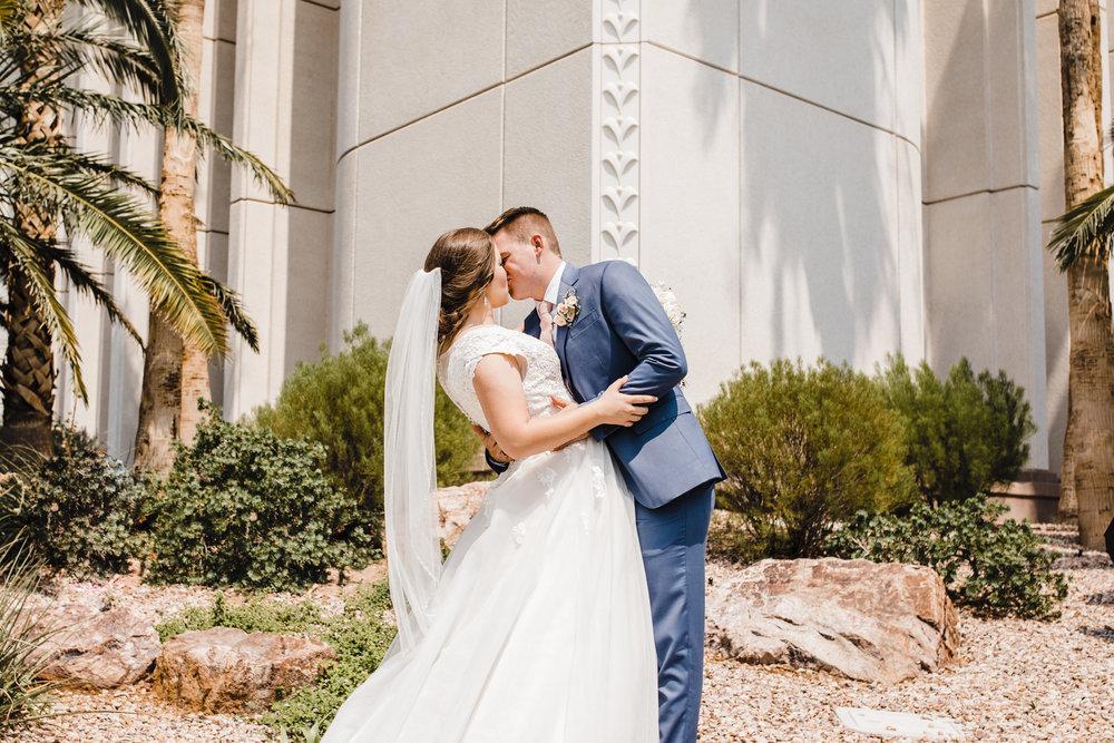 professional las vegas wedding photographer kissing lds temple hugging romantic