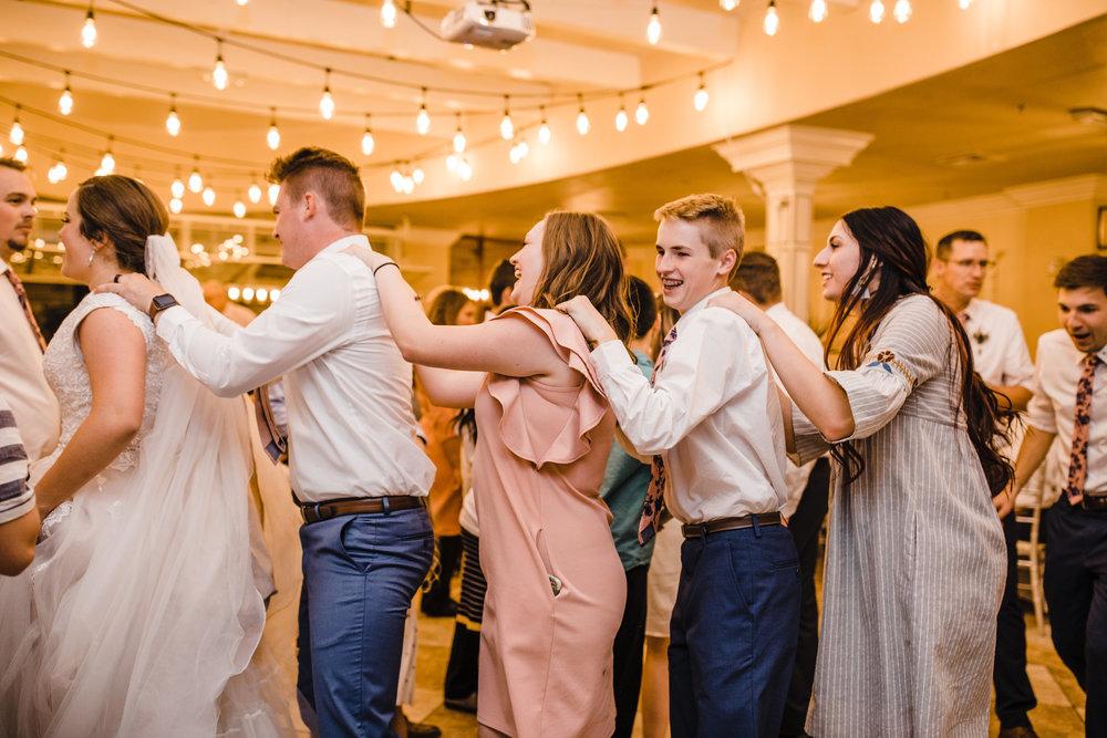 professional las vegas wedding photographer wedding reception dance line shoulders happy laughing