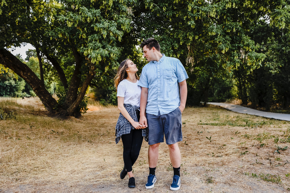 best cache valley couples photographer denzel stewart park holding hands walking stares