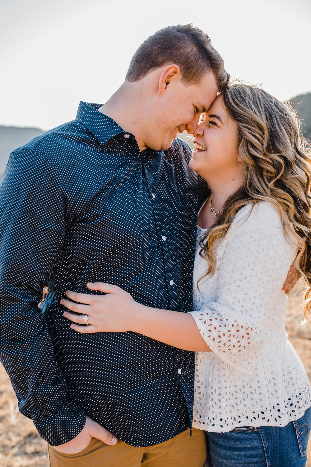 logan utah engagement photographer hugging laughing mountains playful