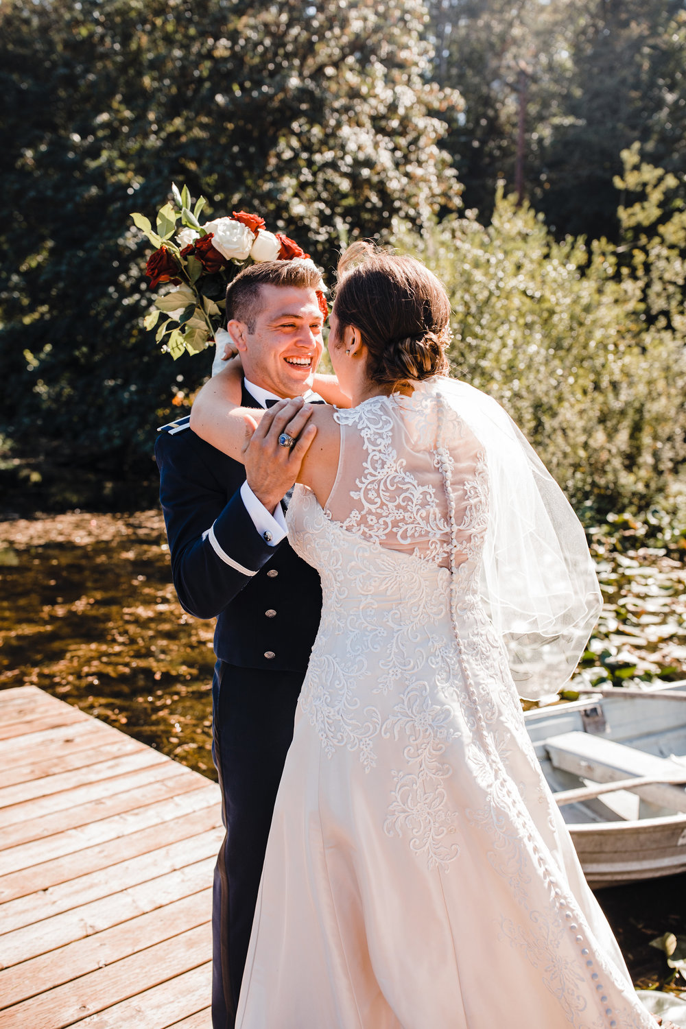 best wedding photographer in olympia washington first look happy hugging smiling military wedding
