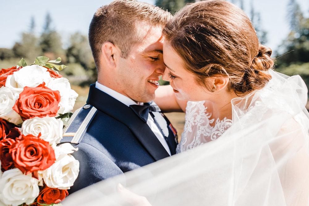 best wedding photographer olympia washington blowing veil kissing romantic smiling military wedding