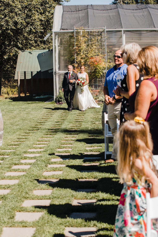 olympia washington wedding photographer outdoor ceremony isle standing