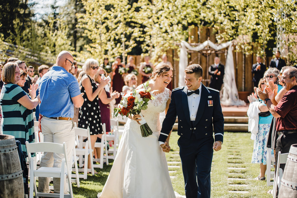 professional olympia washington wedding photographer wedding exit outdoor ceremony organza wedding arch military wedding