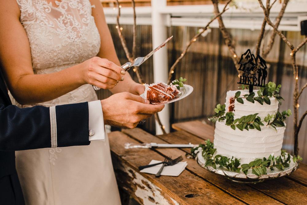 olympia washington wedding photographer cake cutting holding hands wedding cake