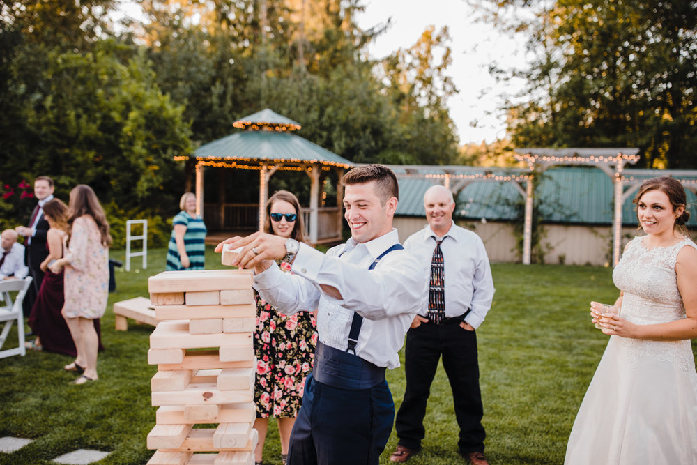 professional best olympia washington wedding photographer reception outdoor lawn games jenga groom