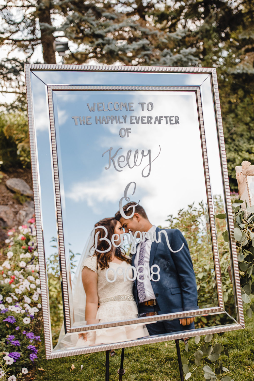 professional wedding photographer utah valley wedding sign outdoor ceremony mirror