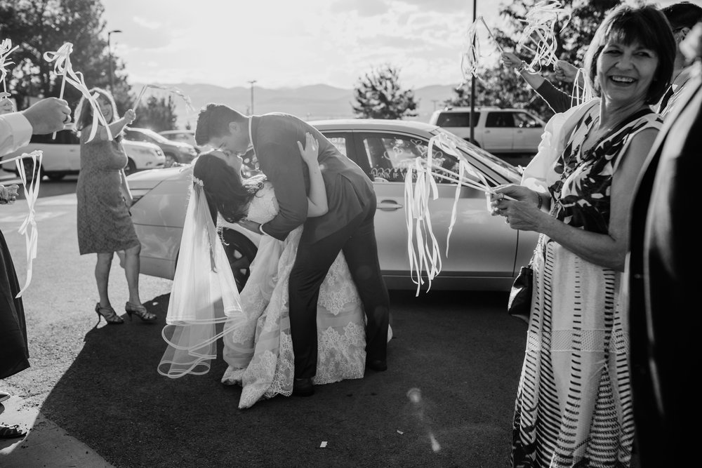 best provo utah wedding photographer wedding exit kissing dipping decorated car