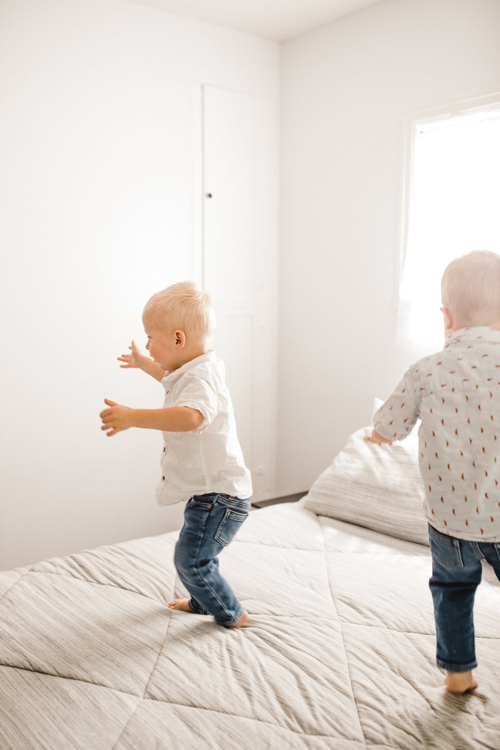 best lifestyle photographer in logan utah twins toddlers jumping bed