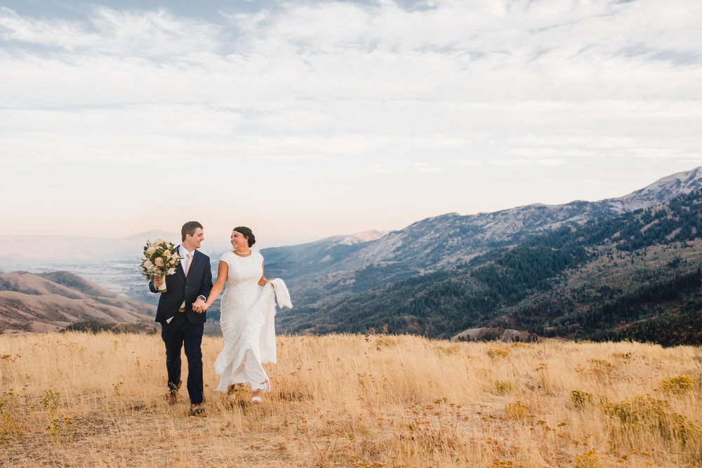 best formal photographer logan utah mountain backdrop holding hands laughing walking