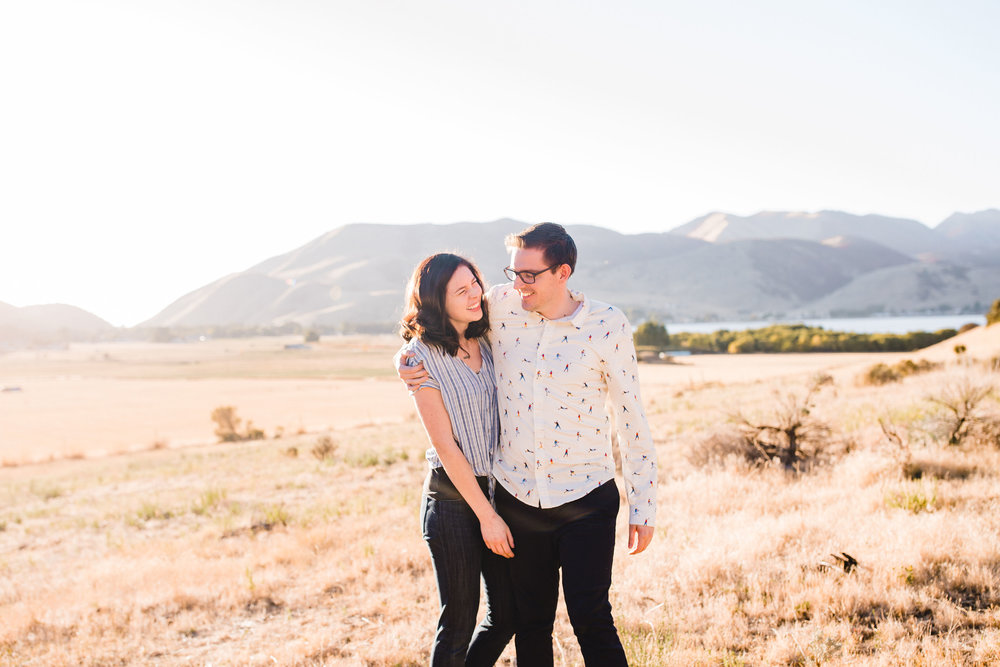 best professional engagement photographer cache valley utah hugging walking mountains fields happy